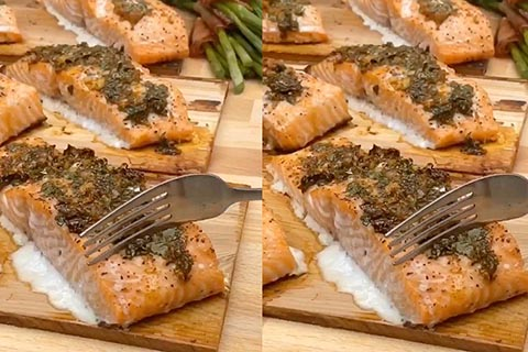 Cedar planked salmon filets topped with garlic & herb sauce fueled by James Brown